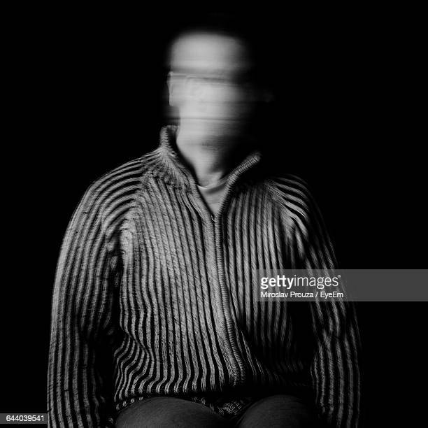 Blur Face Of Man Against Black Background
