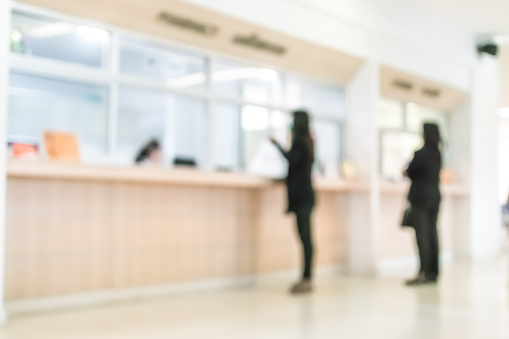 Blur medical background customer or patient service counter, office lobby, or bank  interior 1127651156