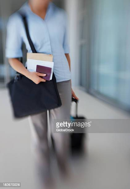 Blur motion of an airline passenger with a trolley bag