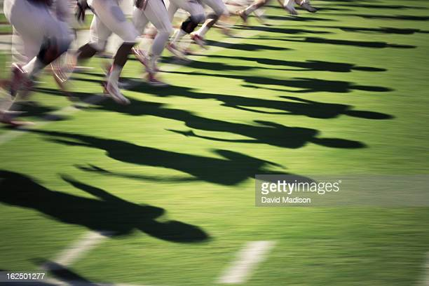 blur of american football players. - rush american football stock pictures, royalty-free photos & images