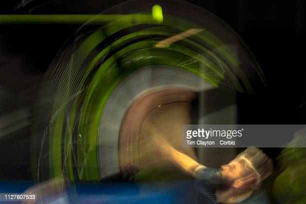 A blur of motion as Benoit Paire of France serves duding his match against Evgeny Donskoy of Russia at the Open Sud de France Tennis Tournament at...