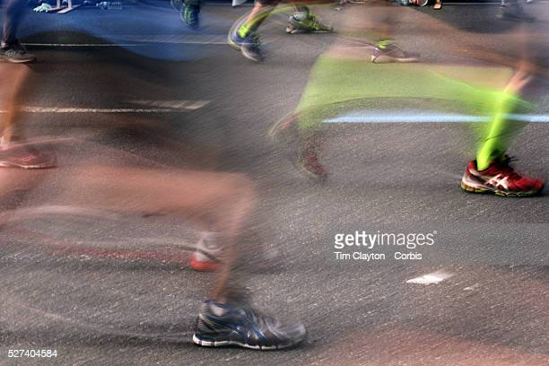 A blur of motion as runners feet make their way along First Avenue in Manhattan New York during the ING New York Marathon New York USA 3rd November...