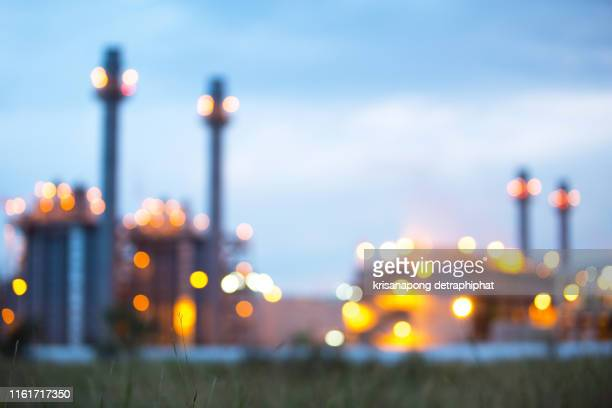 blur power plant at night - refinery stock pictures, royalty-free photos & images