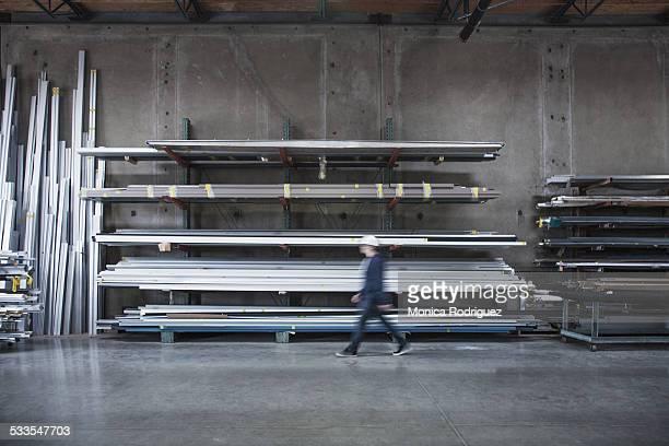 Blur worker walks through warehouse