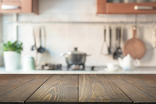 Blurred abstract background. Modern kitchen with tabletop and space for display your products. 935971392