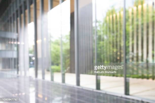 blurred abstract glass wall building background - office ストックフォトと画像