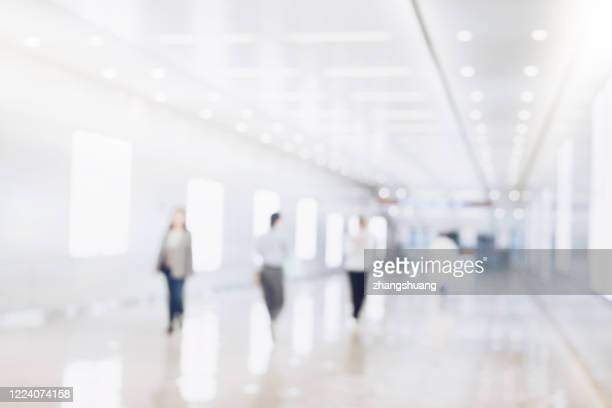 blurred background of businesspeople standing in the corridor of an business center - 滲んだ ストックフォトと画像