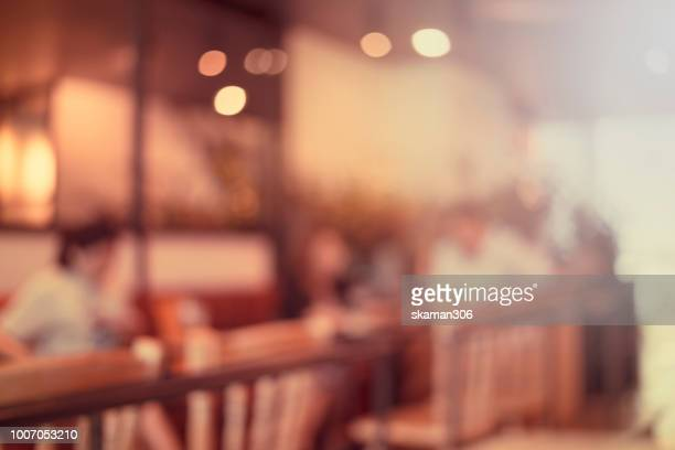 blurred background of cafeteria - vintage restaurant stock pictures, royalty-free photos & images