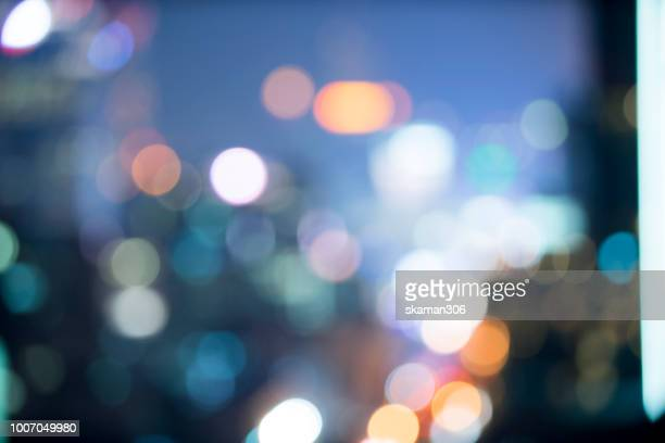 blurred background of nightscape and bokeh background - illuminated stock pictures, royalty-free photos & images