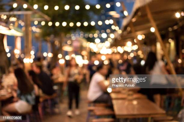 blurred background of restaurant with people. - pub stock pictures, royalty-free photos & images