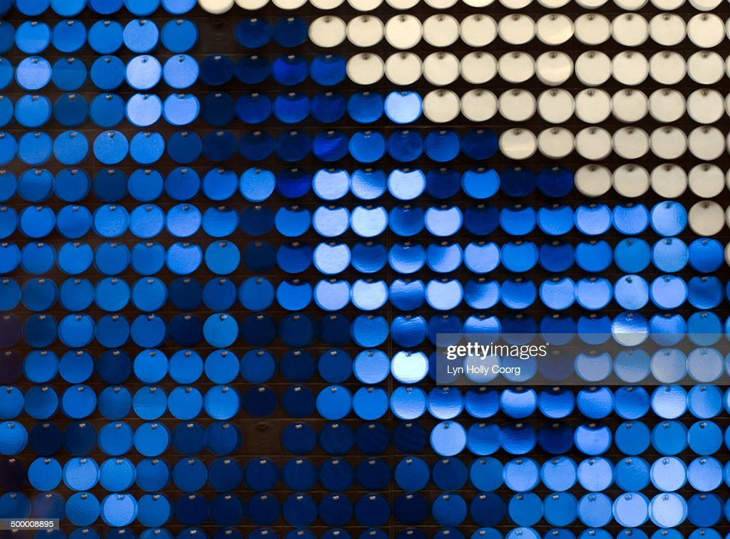 Blurred blue and silver metal discs : Stock Photo