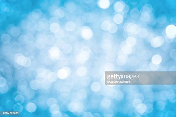 Blurred blue sparkles background with darker corners and bright center