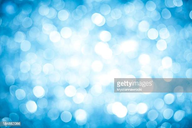 Blurred blue sparkles background with darker corners and bright center.