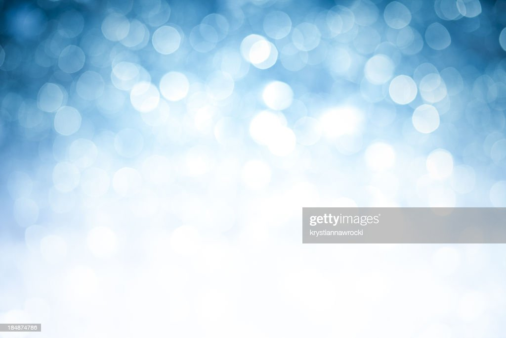Blurred blue sparkles background with darker top corners : Stock Photo