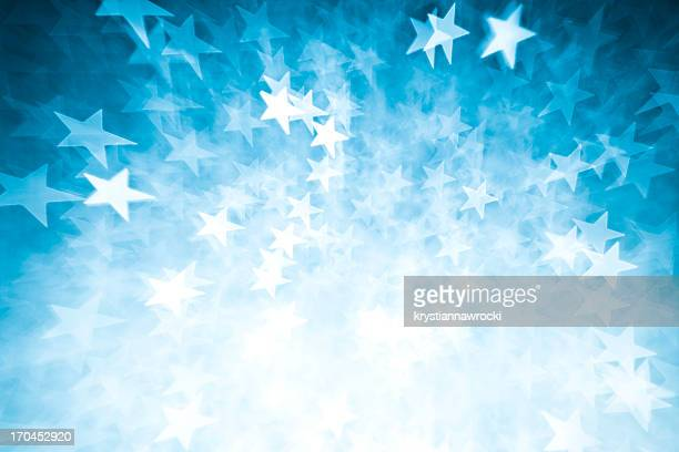 blurred blue star shape lights - star shape stock pictures, royalty-free photos & images