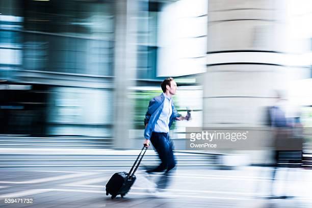 Blurred Business man running through building