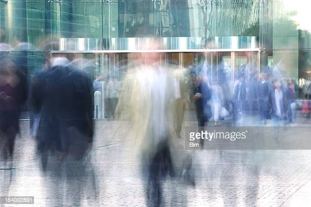 Blurred Business People Entering and Leaving Office Building
