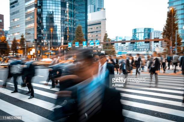 blurred business people on their way from work - crossing stock pictures, royalty-free photos & images