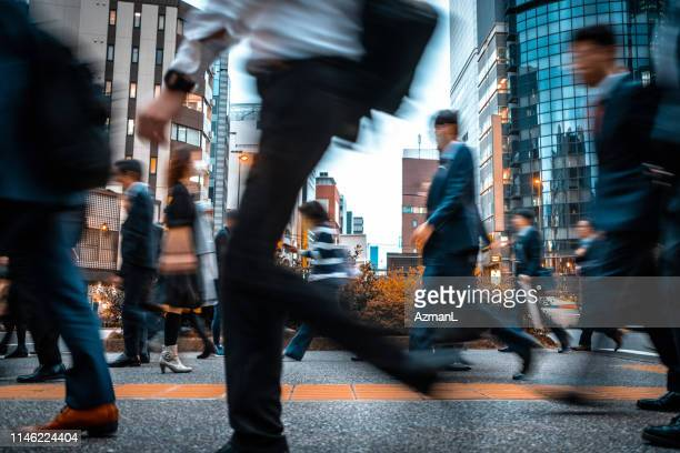 blurred business people on their way from work - commuter stock pictures, royalty-free photos & images