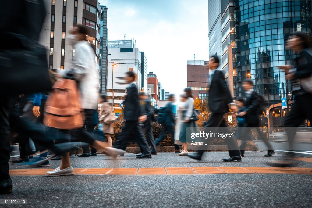 Blurred business people on their way from work : Stock Photo