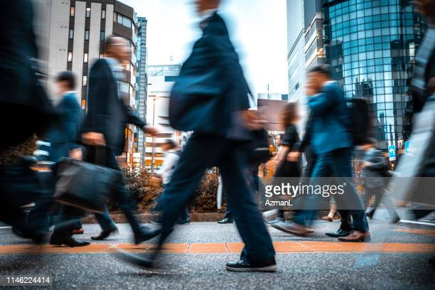 blurred business people on their way from work - business finance and industry stock pictures, royalty-free photos & images