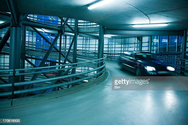 Blurred Car in Spiral Exit From a Parking Garage