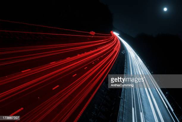 Blurred car lights from fast moving cars on motorway