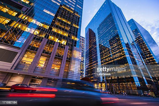 blurred car lights in motion on street in calgary at sunset - calgary stock pictures, royalty-free photos & images