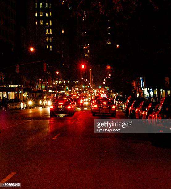 blurred cars at night on new york street - lyn holly coorg stock pictures, royalty-free photos & images