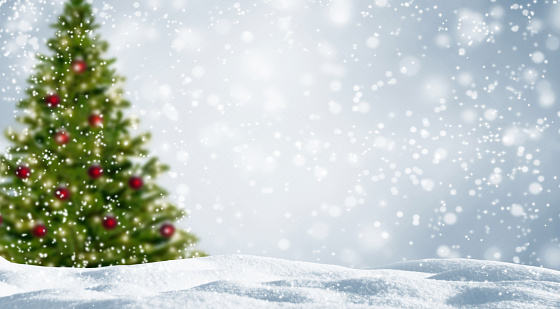 blurred christmas tree in white snowy landscape 1048876592