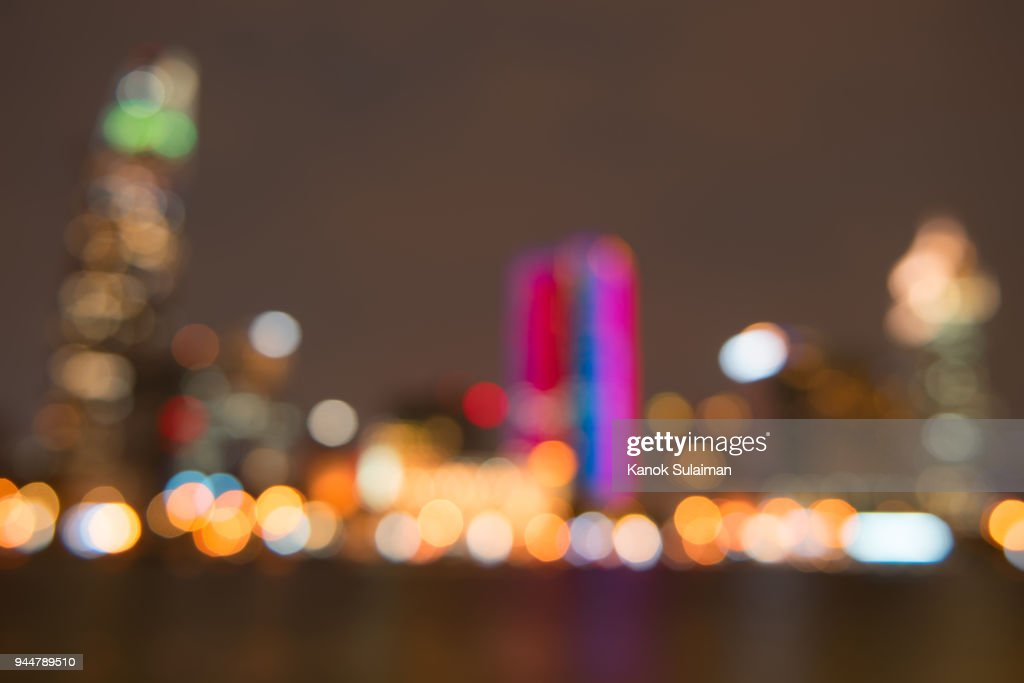 Blurred city lights and office buildings : Stock Photo