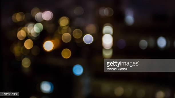 blurred city lights at night - soft focus stock pictures, royalty-free photos & images