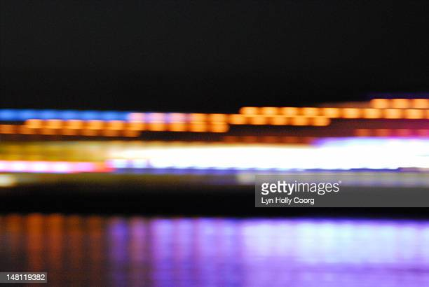 blurred, coloured city lights reflected in water - lyn holly coorg stock pictures, royalty-free photos & images