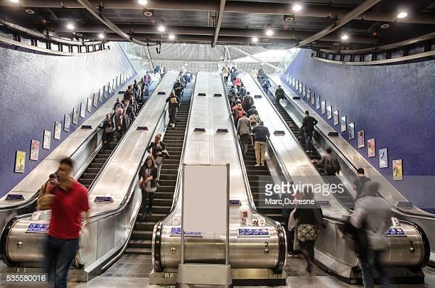 Blurred crowd in escalator of London Subway Station
