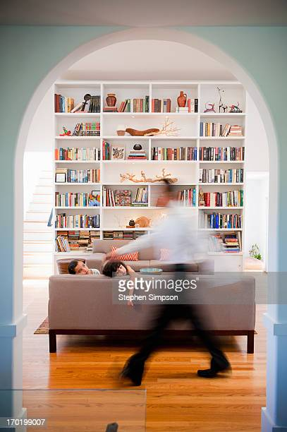 blurred dad crosses the girls in the living room - arch stock pictures, royalty-free photos & images