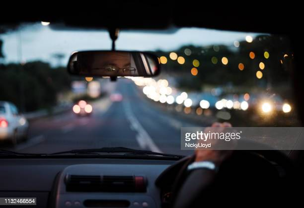 blurred drive in night - driving stock pictures, royalty-free photos & images