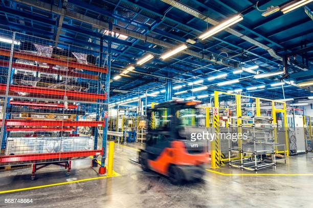 Blurred forklift in factory