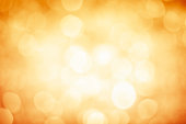 Blurred gold sparkles background with darker corners and bright center
