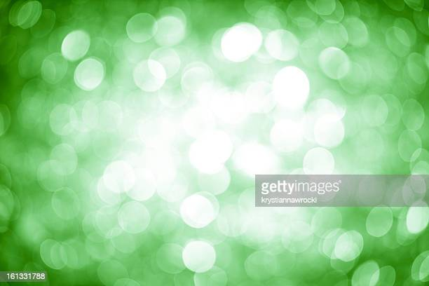 Blurred green sparkles.