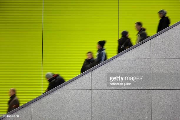 Blurred image of a busy escalator