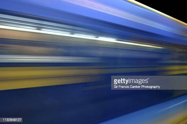 blurred image of a fast metro train in tehran's metro network, iran - moving past stock pictures, royalty-free photos & images
