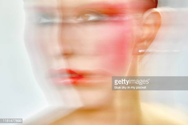 a blurred image of a young woman's face - erin james stock-fotos und bilder