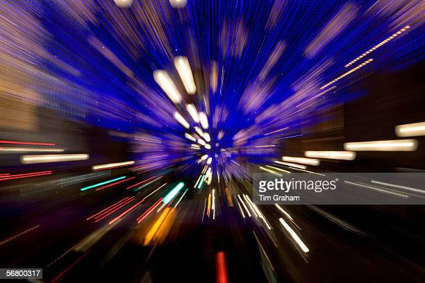Blurred image of Christmas decorations and traffic in Regent Street London United Kingdom