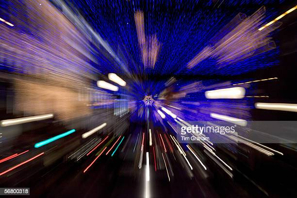 Blurred image of Christmas decorations and traffic in Regent Street, London, United Kingdom.