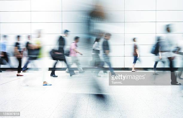 blurred image of commuters in hong kong - motion blur stock photos and pictures