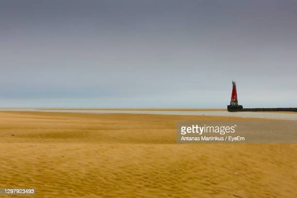 blurred image of lighthouse against sky - low tide stock pictures, royalty-free photos & images