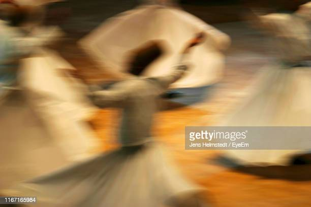 blurred image of people dancing on street - jens helmstedt stock-fotos und bilder