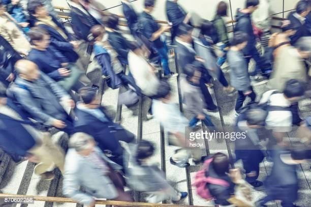 blurred image of people - crowded subway stock photos and pictures