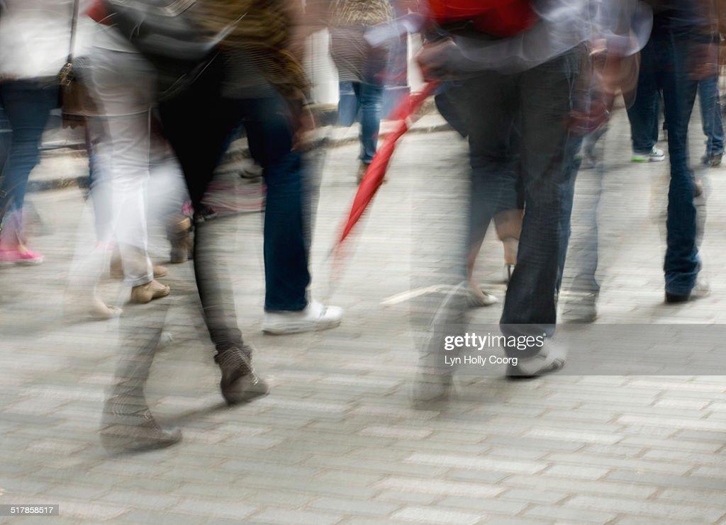 Blurred image of people walking on street : Stock Photo