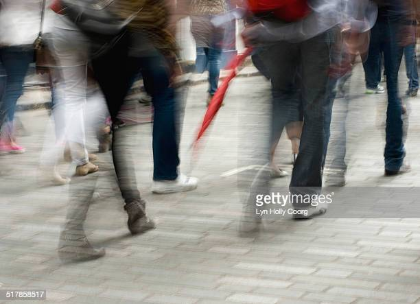 blurred image of people walking on street - lyn holly coorg stock photos and pictures
